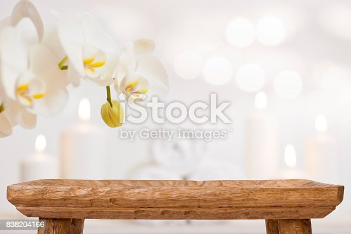 istock Empty wooden table on blurred abstract background of spa products 838204166