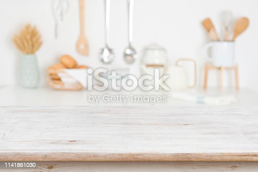 Empty wooden table on blurred kitchen accessories background, copy space
