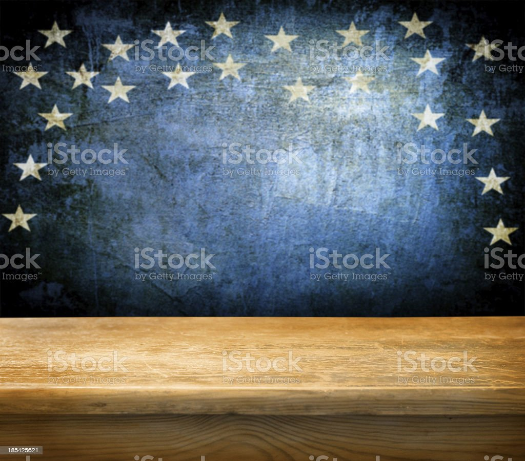 Empty wooden table over a blue background with stars stock photo