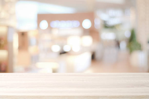 Empty wooden table over blur store background, product and food display montage background stock photo