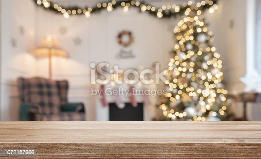 Empty wooden table over defocused christmas background with copy space