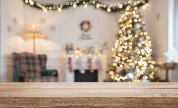 empty wooden table over defocused christmas background - christmas table foto e immagini stock