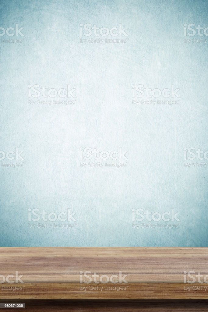 Empty wooden table over green cement wall  background, for product display montage royalty-free stock photo