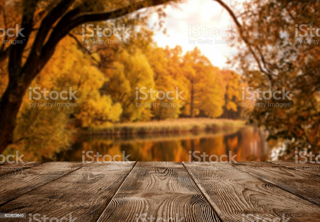 Empty wooden table over the autumn landscape stock photo