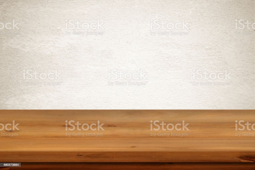 Empty wooden table over vintage cement wall background, product display montage, template royalty-free stock photo