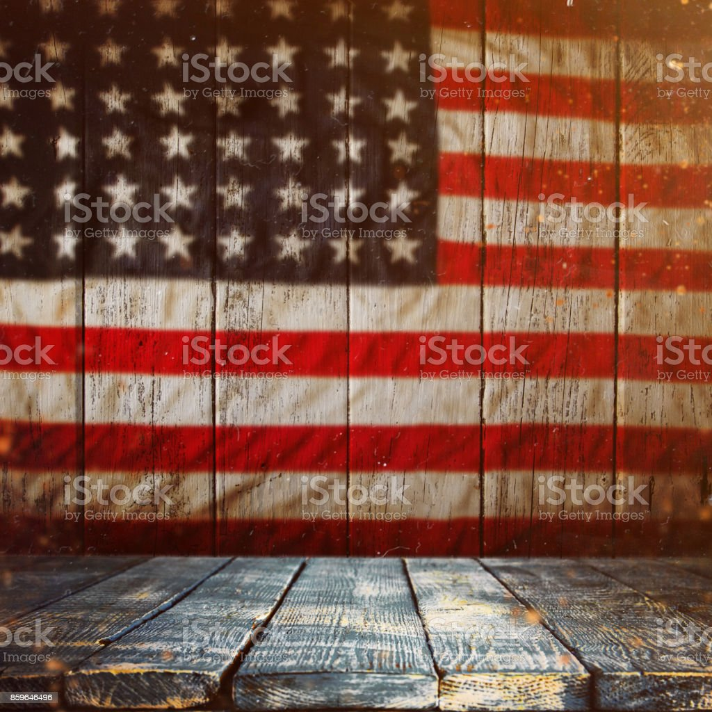 Empty wooden table over vintage USA flag background stock photo