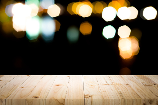 498688230 istock photo Empty wooden table platform and bokeh at night 1064871456