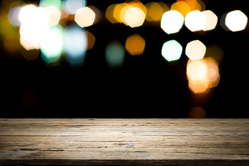 498688230 istock photo Empty wooden table platform and bokeh at night 1064871480