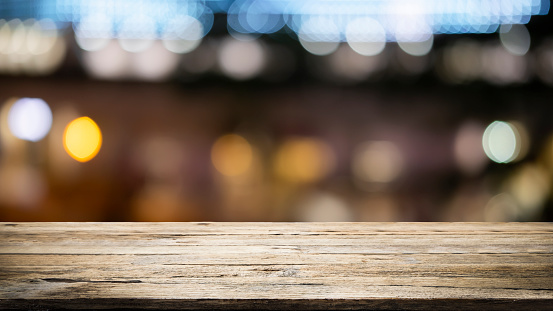 841276206 istock photo Empty wooden table platform and bokeh at night 1179185356