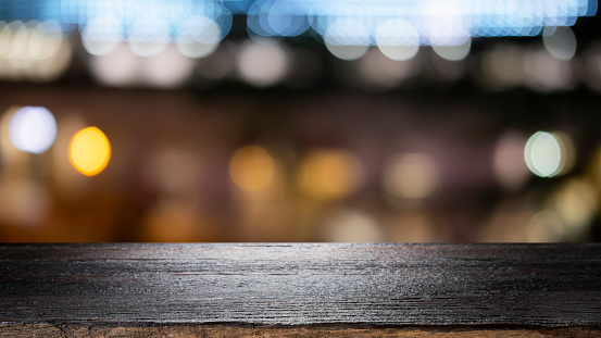 841276206 istock photo Empty wooden table platform and bokeh at night 1179185369