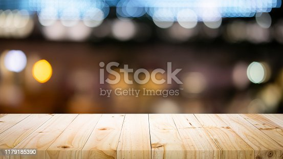 841276206istockphoto Empty wooden table platform and bokeh at night 1179185390