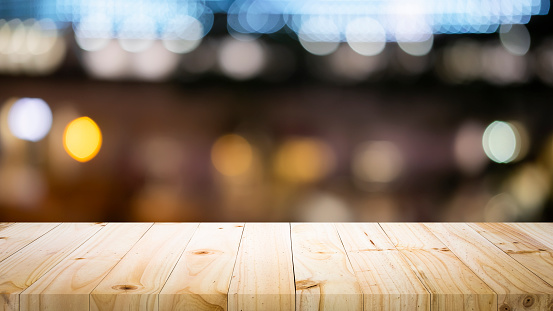 841276206 istock photo Empty wooden table platform and bokeh at night 1179185390