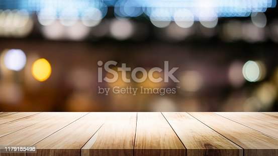 841276206istockphoto Empty wooden table platform and bokeh at night 1179185498