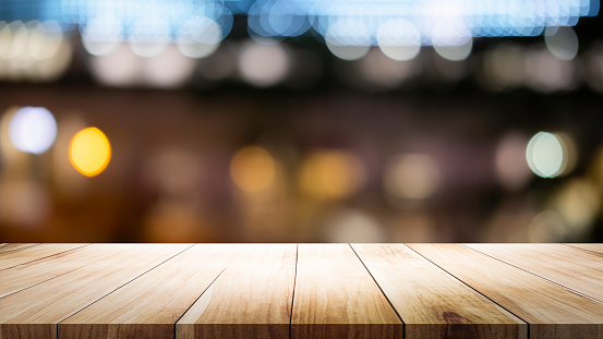 841276206 istock photo Empty wooden table platform and bokeh at night 1179185498