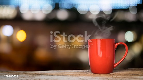 841276202istockphoto Empty wooden table platform and bokeh at night 1179185521