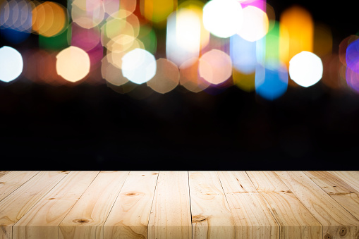 841276206 istock photo Empty wooden table platform and bokeh at night 1194108998