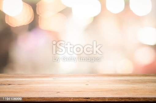 841276206istockphoto Empty wooden table platform and bokeh at night 1194108999