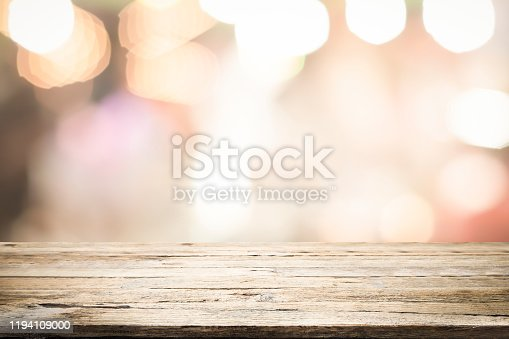841276206istockphoto Empty wooden table platform and bokeh at night 1194109000
