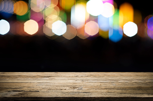 841276206 istock photo Empty wooden table platform and bokeh at night 1194109001