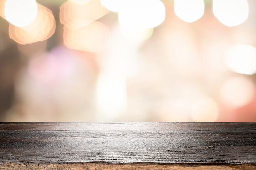 841276206 istock photo Empty wooden table platform and bokeh at night 1194109002