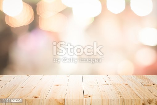 841276206istockphoto Empty wooden table platform and bokeh at night 1194109005