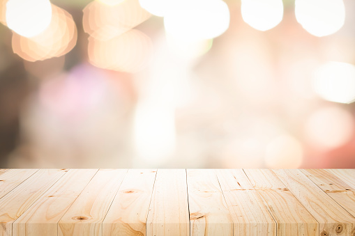 841276206 istock photo Empty wooden table platform and bokeh at night 1194109005