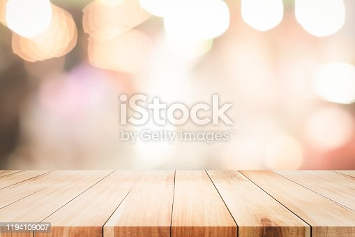 841276206istockphoto Empty wooden table platform and bokeh at night 1194109007