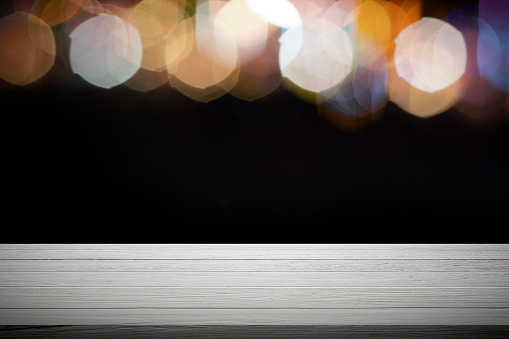 841276206 istock photo Empty wooden table platform and bokeh at night. 1205424119