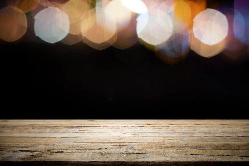 841276206 istock photo Empty wooden table platform and bokeh at night. 1205424120