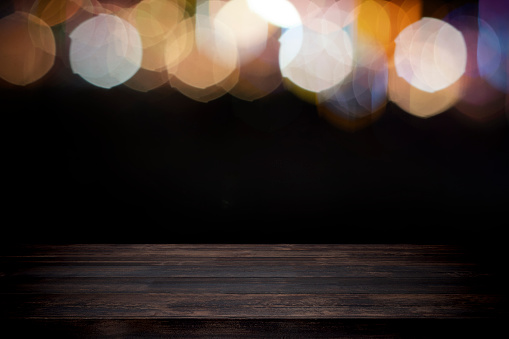 841276206 istock photo Empty wooden table platform and bokeh at night. 1205424122