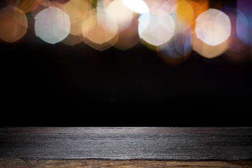 841276206 istock photo Empty wooden table platform and bokeh at night. 1205424124
