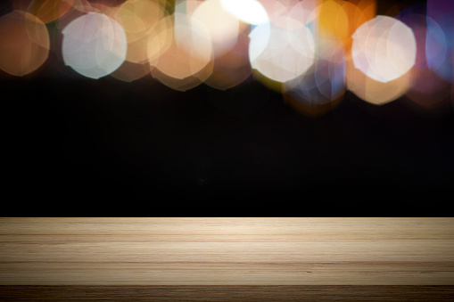 841276206 istock photo Empty wooden table platform and bokeh at night. 1208570671