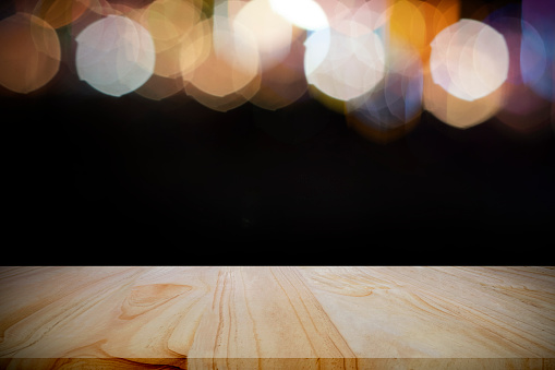 841276206 istock photo Empty wooden table platform and bokeh at night. 1208570673
