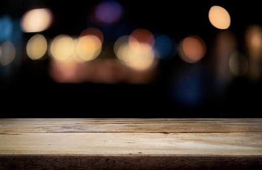 841276206 istock photo Empty wooden table platform and bokeh at night 841276194