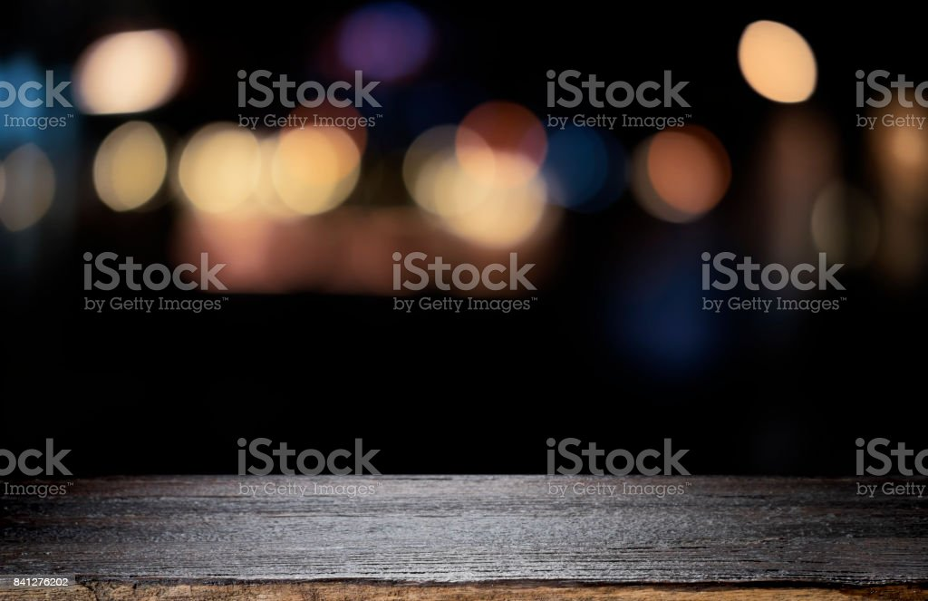 Empty wooden table platform and bokeh at night royalty-free stock photo