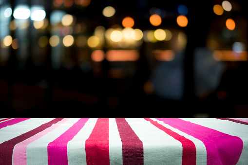 498688230 istock photo Empty wooden table platform and bokeh at night 921984730