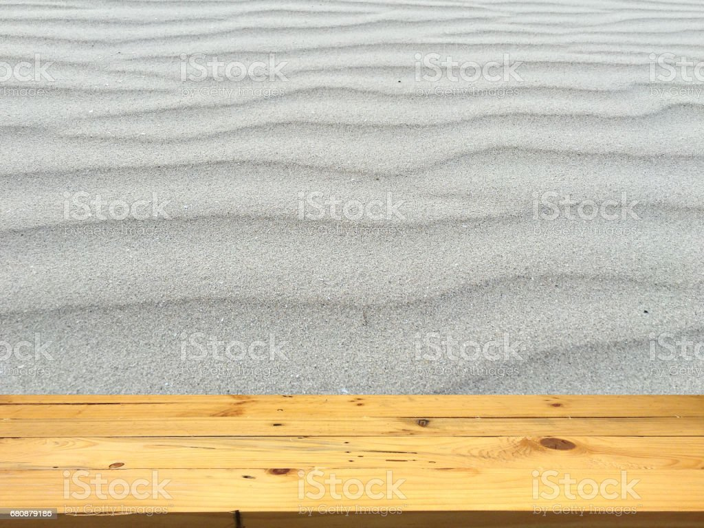 Empty wooden table space platform and blurred Beach sand background for product display montage royalty-free stock photo