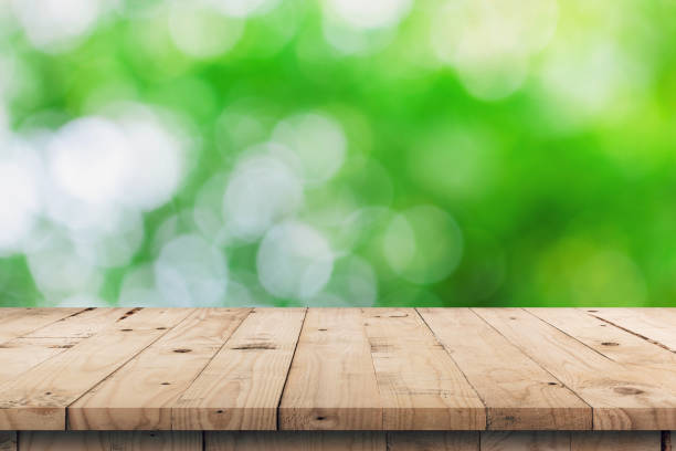 empty wooden table top and green bokeh display montage for product with space. - top view, wood table, empty imagens e fotografias de stock