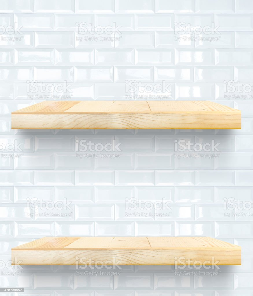 Empty Wooden Table top and shelf at white tile wall stock photo