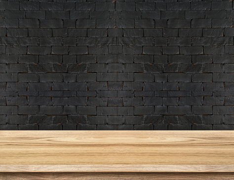 593305530 istock photo Empty Wooden Table top at black brick wall 484863810