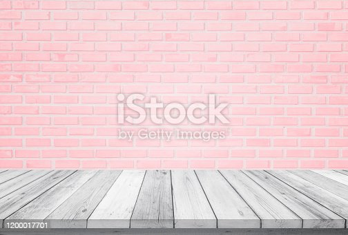 834157738 istock photo Empty wooden table top isolated on pink brick white background, Design Wood terrace white. Free space for your copy and branding. Can be used as product display montage. Vintage style concept. 1200017701