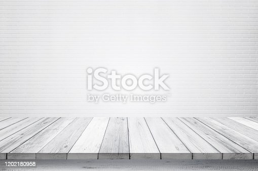 834157738 istock photo Empty wooden table top isolated on white brick white background, Design Wood terrace white. Free space for your copy and branding. Can be used as product display montage. Vintage style concept. 1202180958