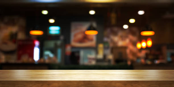 empty wooden table top with blur coffee shop or restaurant interior background, panoramic banner. - diminishing perspective stock pictures, royalty-free photos & images