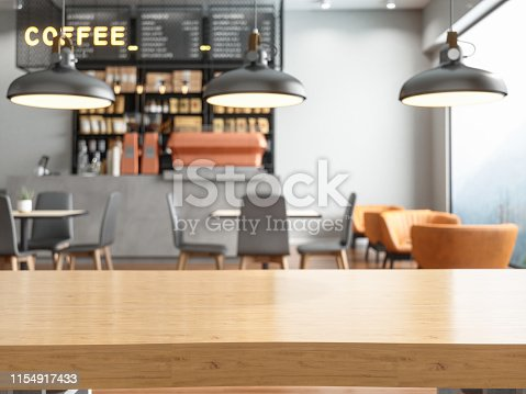 Empty wooden table top with blur coffee shop