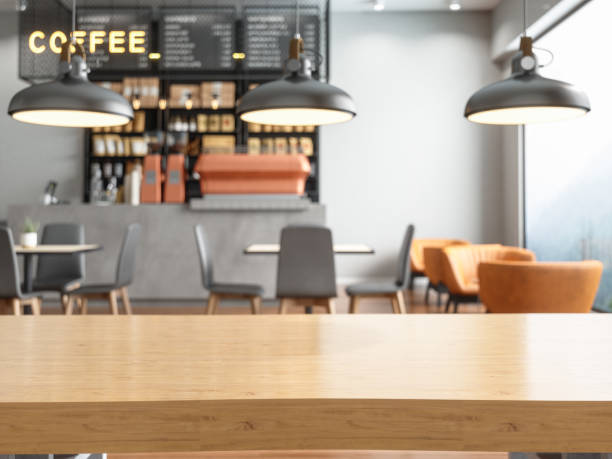 블러 커피숍이 있는 빈 나무 테이블 탑 - 카페 뉴스 사진 이미지