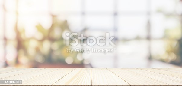 istock Empty wooden table top with cafe restaurant coffee shop window interior abstract blur defocused with bokeh light background for montage product display 1151887844