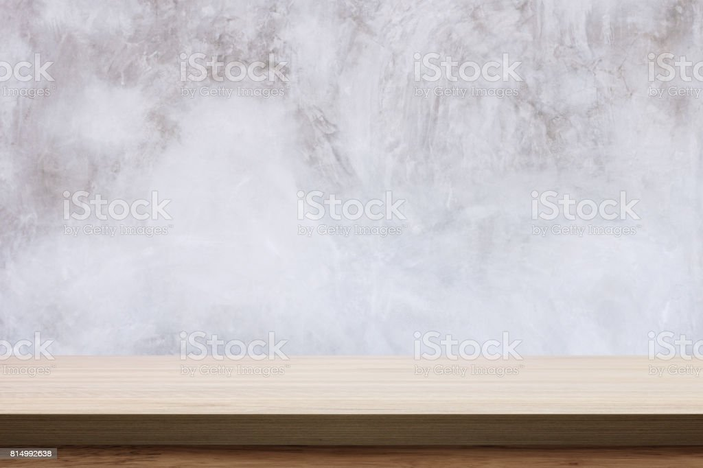 Empty wooden table with bare concrete wall background. stock photo