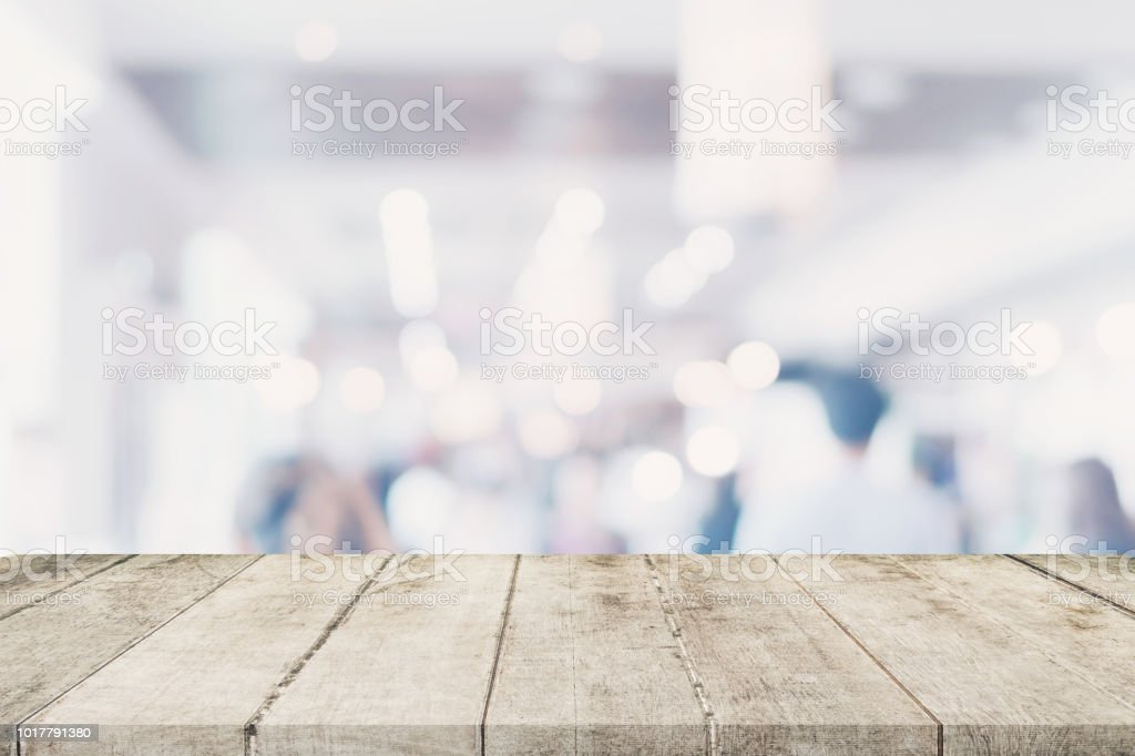 Empty wooden table with blurred abstract people on cafe on restaurant...