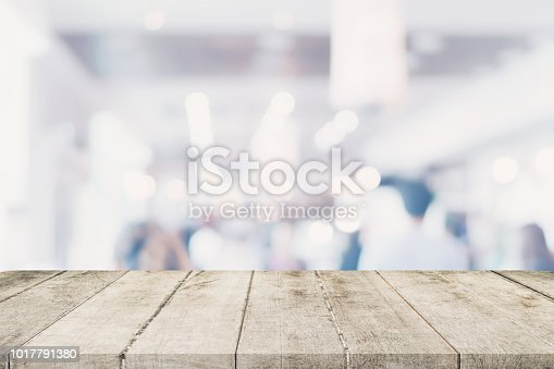 862429776 istock photo Empty wooden table with blurred abstract people on cafe on restaurant background. 1017791380
