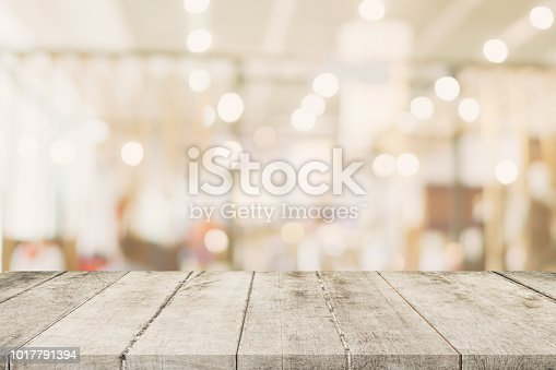 862429776 istock photo Empty wooden table with blurred abstract people on cafe on restaurant background. 1017791394